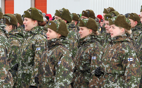 Female soldiers in form, mouths open.