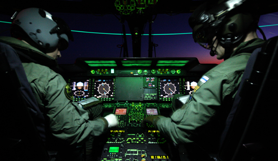 Pilots in the cockpit of a NH90 helicopter in night time